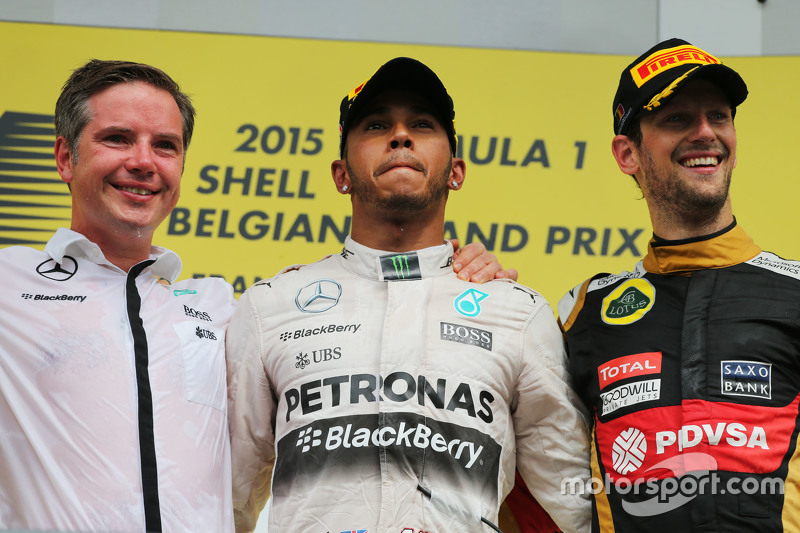 The podium,: race winner Lewis Hamilton, Mercedes AMG F1 with third placed Romain Grosjean, Lotus F1 Team on the podium