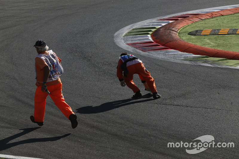Marshals pick up debris from track