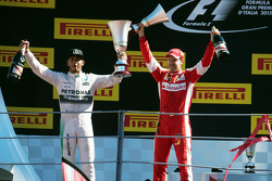 (L to R): Race winner Lewis Hamilton, Mercedes AMG F1 celebrates with second placed Sebastian Vettel, Ferrari on the podium