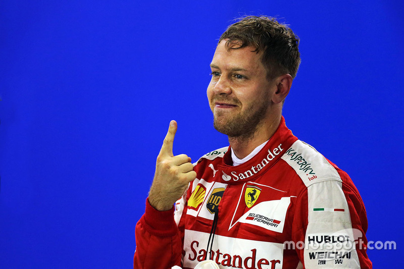 Sebastian Vettel, Ferrari celebrates his pole position in parc ferme