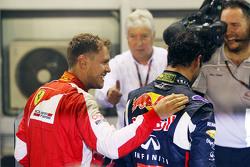 Sebastian Vettel, Ferrari, festeggia la vittoria nel parco chiuso con il secondo classificato Daniel Ricciardo, Red Bull Racing