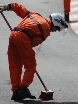 A marshall sweeps away debris