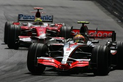 Lewis Hamilton, McLaren Mercedes, MP4-22 and Ralf Schumacher, Toyota Racing, TF107