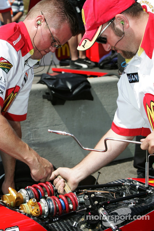 Newman/Haas/Lanigan Racing crew members makes suspension adjustements on the car of Sébastien Bourdais