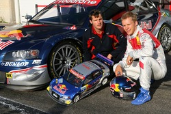 Martin Tomczyk, with an electric RC car, races against his team mate Mattias Ekström, in a real Audi A4 DTM car