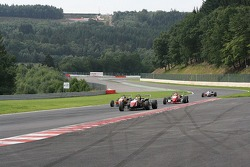 Stephen Jelley towing a gaggle of F3 cars uphill to the Bus Stop
