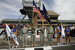 Miller Motorsports Park girls pose with members of the armed forces
