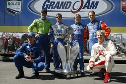Grand Am Rolex Series past champions Terry Borcheller, Max Papis, Scott Pruett, Wayne Taylor, Max Angelelli and Jorg Bergmeister pose with the championship trophy