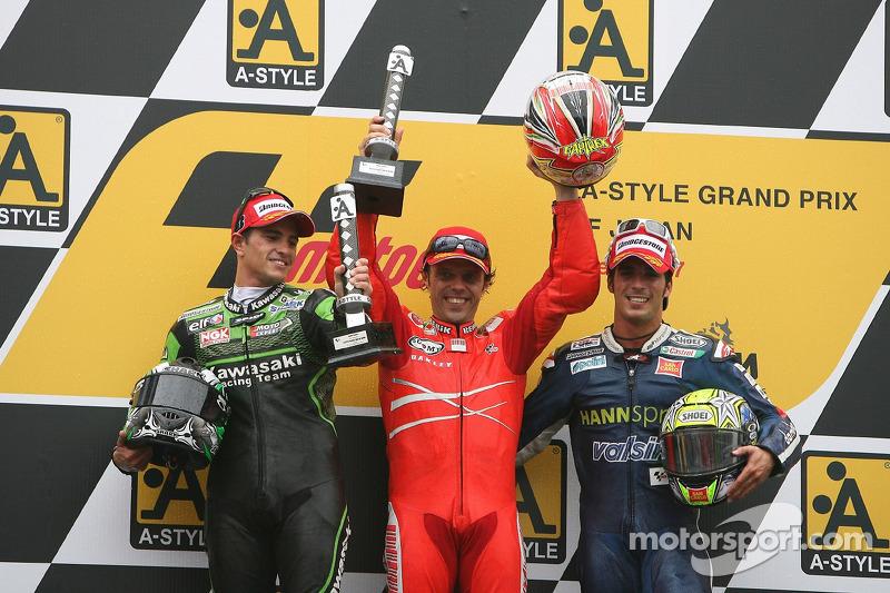 Winner Loris Capirossi with Randy de Puniet and Toni Elias on the podium