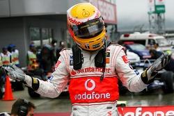 Pole winner Lewis Hamilton, McLaren Mercedes, celebrates