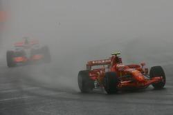 Kimi Raikkonen, Scuderia Ferrari, F2007 leads Fernando Alonso, McLaren Mercedes, MP4-22
