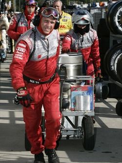 Audi Sport North America team member carries fuel