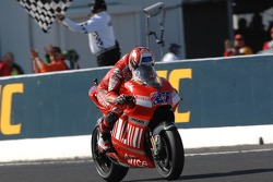 Casey Stoner takes the checkered flag