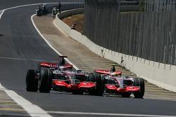 Fernando Alonso, McLaren Mercedes passes Lewis Hamilton, McLaren Mercedes rolls towards the pits