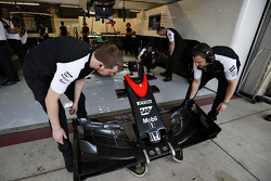 McLaren mechanics with a nose cone