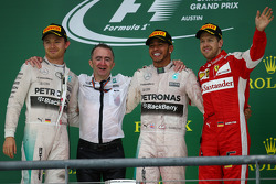 The podium: Second place Nico Rosberg, Mercedes AMG F1, Race winner and World Champion Lewis Hamilton, Mercedes AMG F1, and third place Sebastian Vettel, Ferrari