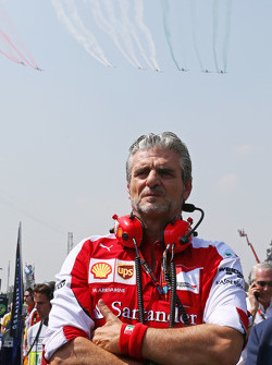 Maurizio Arrivabene, Ferrari Team Principal on the grid as a planes fly over