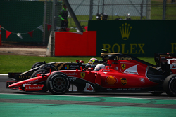 Sebastian Vettel, Ferrari SF15-T and Pastor Maldonado, Lotus F1 E23 battle for position