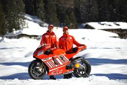 Marco Melandri and Casey Stoner pose with the Ducati Desmosedici GP8