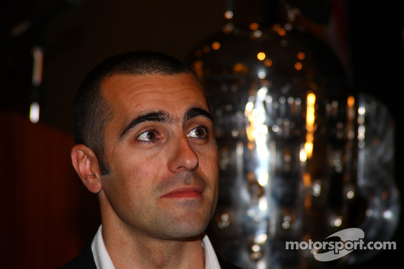 2007 Indianapolis 500 winner Dario Franchitti with the Borg-Warner Trophy in the background