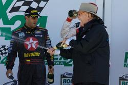 DP podium: Dan Gurney sprays champagne