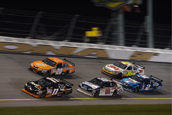 Denny Hamlin leads a group of cars