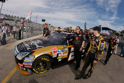 Jamie McMurray pushes his car to pit road