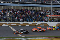 Denny Hamlin takes the checkered flag in front of Tony Stewart