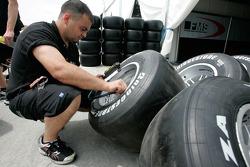 A Fisichella Motor Sport International mechanic checks tyre pressures