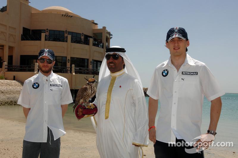 Nick Heidfeld and Robert Kubica with a falcon