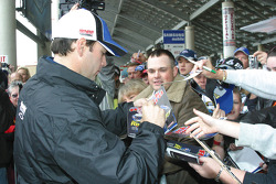 Jimmie Johnson signs autographs for his fans
