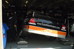 Work on Scott Riggs' car in the garage area