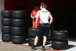 Bridgestone technician with slick tyres