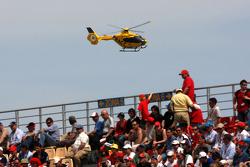 Heikki Kovalainen, McLaren Mercedes is flown to hospital after crashing