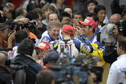 Race winner Valentino Rossi celebrates