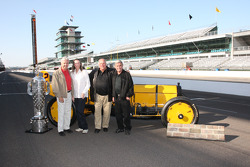 Rick Mears, Mari Hulman George, A.J. Foyt and Al Unser Sr. pose with the Borg Warner trophy and the Marmon Wasp