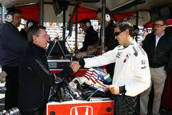 Johnny Rutherford greets Graham Rahal