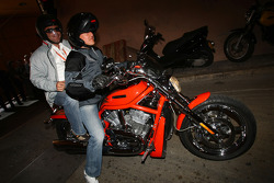 Michael Schumacher, Test Driver, Scuderia Ferrari leaving the paddock on a Harley-Davidson motorcycle