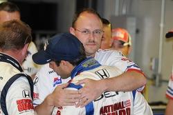 Vitor Meira gives a crew member a hug