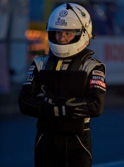 A driver waits for his next stint