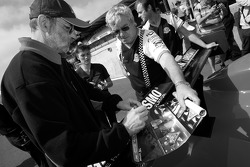 Henri Pescarolo signs autographs