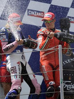 Podium: champagne for Casey Stoner