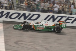 Race winner Tony Kanaan takes the checkered flag