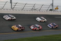 Denny Hamlin and Kyle Busch lead a group of cars