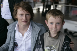 Mike Conway with a young fan