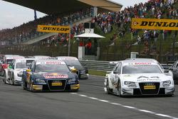 Start: Tom Kristensen, Audi Sport Team Abt, Audi A4 DTM, leads Martin Tomczyk, Audi Sport Team Abt Sportsline, Audi A4 DTM, to the first corner