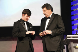 2015 NASCAR Truck Series champion Erik Jones with NASCAR Vice-Chairman Mike Helton