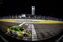 Kyle Busch, Joe Gibbs Racing Toyota crosses the finish line to win the race and the championship