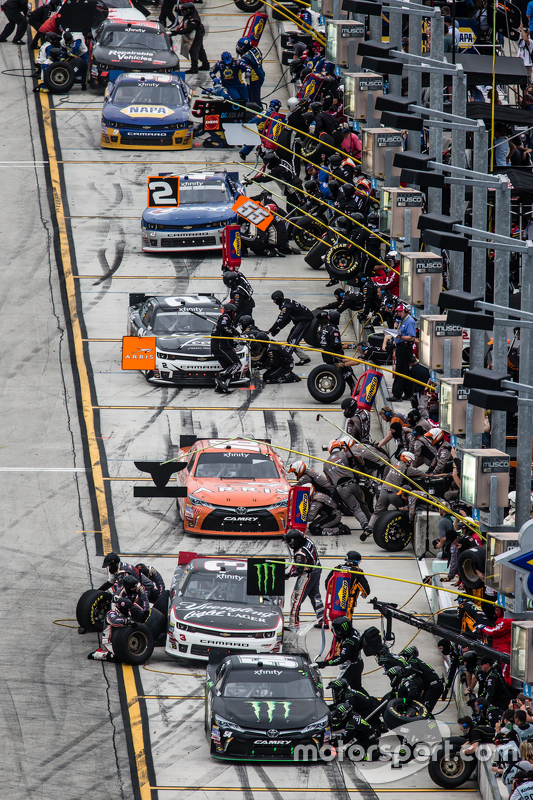 Pit stop for Kyle Busch, Joe Gibbs Racing Toyota and others