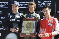 Подиум: Ландо Норрис (победитель), Педро Пике (второе место) и Чжоу Гуанью (третье место)